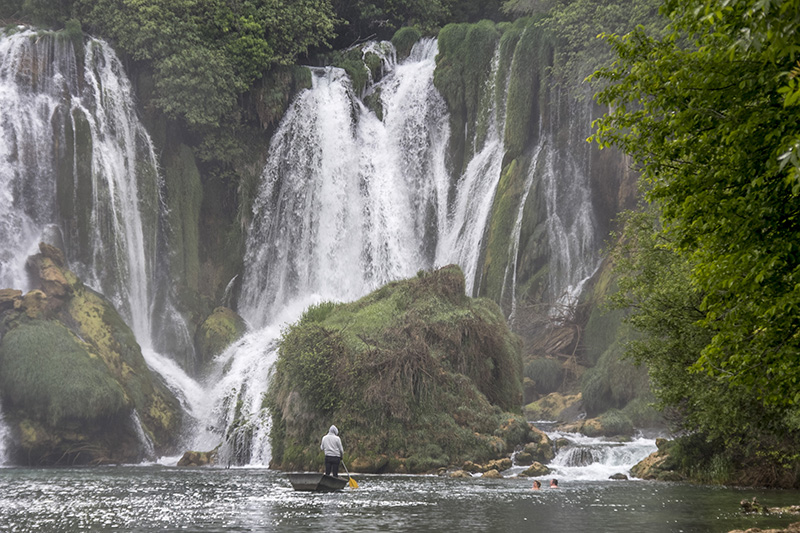 Swimmers at Kravica Falls