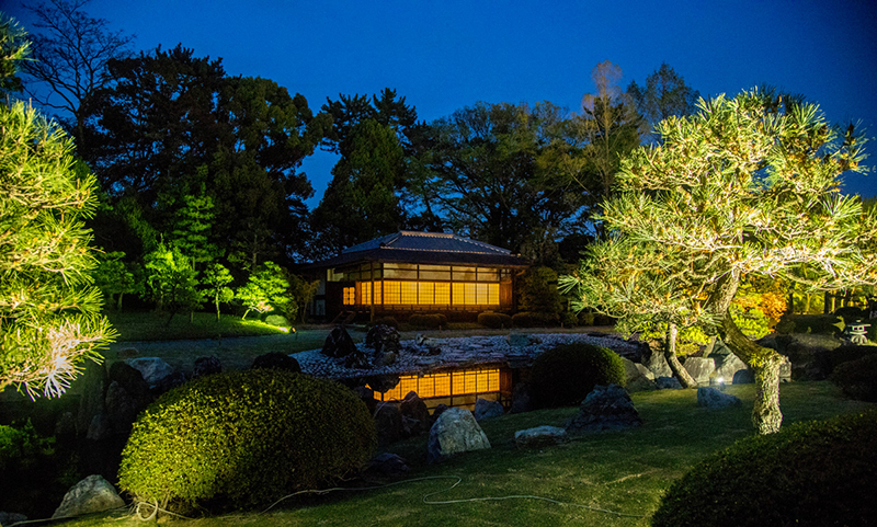 A beautiful lighted building in Nijo Castle Park