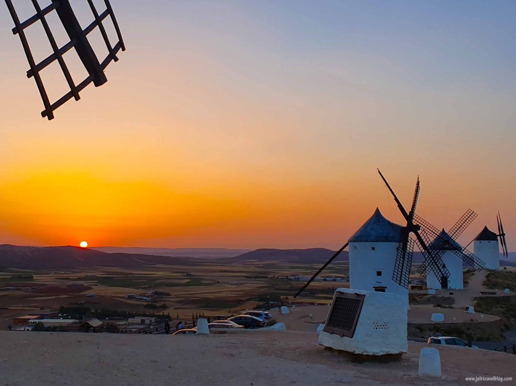 The setting sun at the windmills of Consuegra